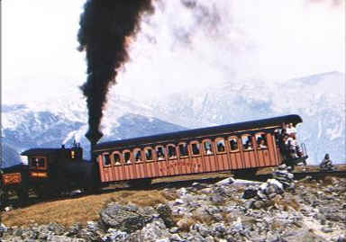 Cog railroad spewing coal while it climbs Mount Washington